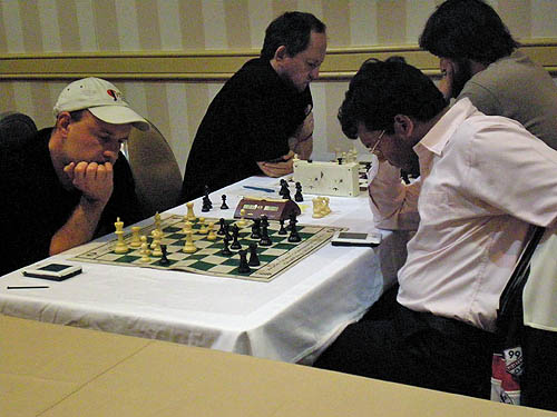 Alexander Shabalov seems to be in trouble against Surya Ganguly, but prevails. Unfortunately, Shabalov suffered a first-round upset and hurt his momentum. Ilya Smirin faces Jiri Stocek in the background.