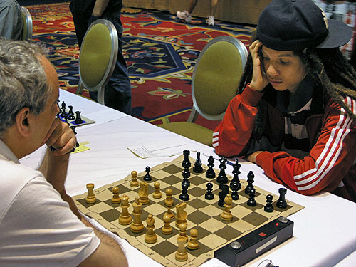 Kassa Korley playing GM Dmitri Gurevich. Photo by Daaim Shabazz.