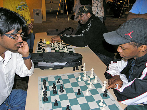 Siddarth Ravichandran of India analyzing his game with Zimbabwe's Farai Mandizha. Ravichandran got an IM norm at the Philadelphia International and got 7-2 at the World Open in the under-2400. Photo by Daaim Shabazz.