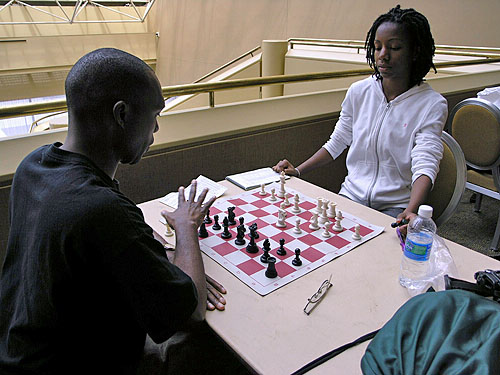 Daaim Shabazz analyzing with Darrian Robinson after their game in round #8. Photo by Daaim Shabazz.
