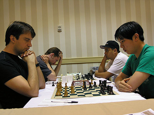 Alexander Stripunksy vs. Canada's FM Bindi Cheng (1-0). Photo by Daaim Shabazz.