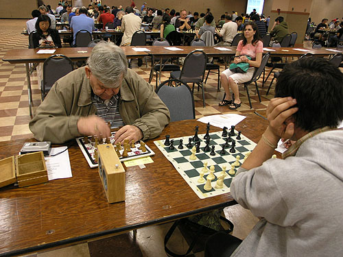 Visually-impaired player using special board and a tape recorder for the moves. Photo by Daaim Shabazz.