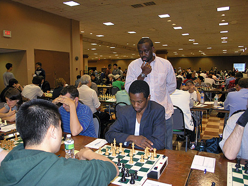 FM Victor Shen vs. IM-elect Farai Mandizha at 2010 World Open. Nigeria's IM Oladapo Adu watching the action. Shen won the section with a remarkable 8/9. Mandizha scored 7½ (losing only to Shen) and Adu tied for 3rd-5th with 7.