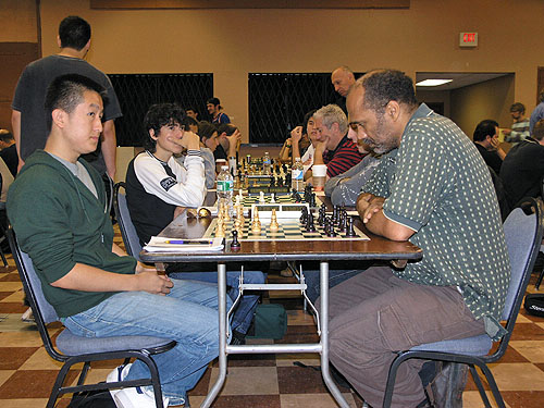 FM Victor Shen playing IM Emory Tate on top board in under-2400 section. Photo by Daaim Shabazz.