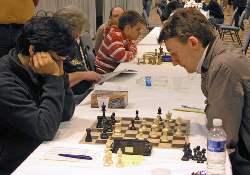 GM Pentala Harikrishna in a battle against GM Luke McShane. Photo by Daaim Shabazz.