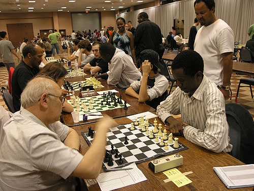 Top boards in under-2400 section. Epic battle unfolds between IM Emory Tate and IM Oladapo Adu. A surging IM-elect Farai Mandizha enroute to a last round win against FM Ilye Figler. Photo by Daaim Shabazz.