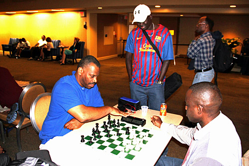 Oladapo Adu blitzing with Herb Carswell with Kamanyola Bior looking on. Photo by Daaim Shabazz.