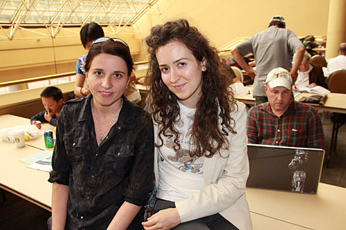Iryna Zenyuk and Irina Krush with Alexander Shabalov in the background.  Photo by Daaim Shabazz.