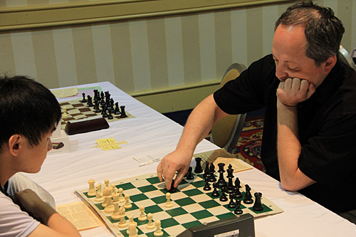 IM Quignan Liu vs. GM Ilya Smirin, 1/2. Photo by Daaim Shabazz.