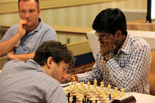IM Shyam Nikhil (India) - GM Sergey Erenburg (Israel), 1/2. Photo by Daaim Shabazz.
