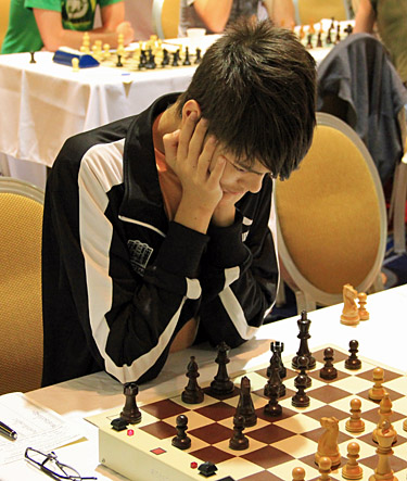 GM Ray Robson ponders his next move. Photo by Daaim Shabazz.