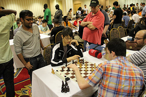 "GM Ray Robson ""Consultation Chess""… Teams of players get to discuss variations during the game. Photo by Daaim Shabazz."