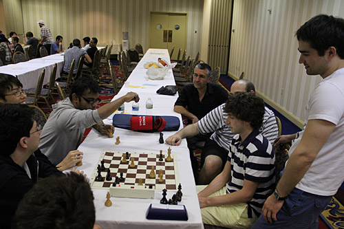Consultation Chess still going on with more players joining in. Photo by Daaim Shabazz.