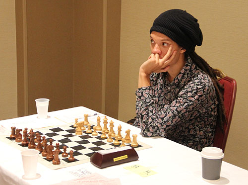 Korley getting ready for next round after drawing with GM Lazaro Bruzon with the Alekhine! Photo by Daaim Shabazz.