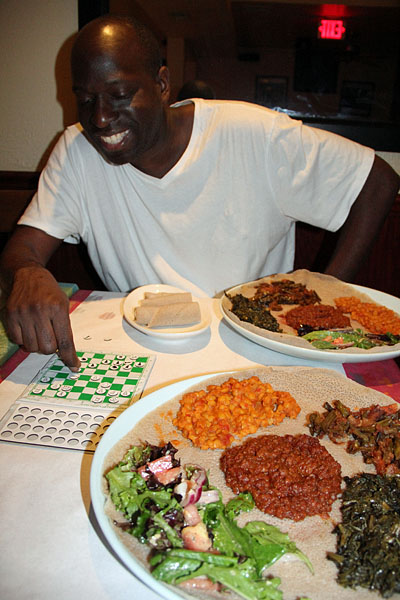 Mario Marshall enjoyed his first taste of Ethiopian. Photo by Daaim Shabazz.