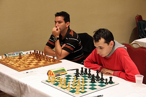 Yuniesky Perez and Alex Lenderman wait on opponents. Photo by Daaim Shabazz.