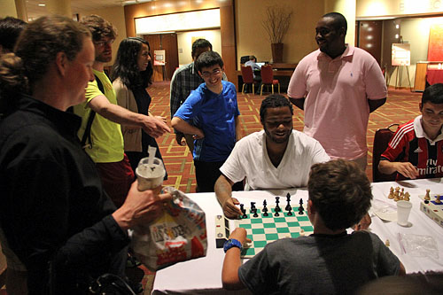 Tavon Carter, blitz extraordanaire playing blitz phenom and triathlete Hans Moke Niemann. Photo by Daaim Shabazz.