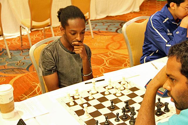 Dominique Myers vs. Kazim Gulamali. Photo by Daaim Shabazz.