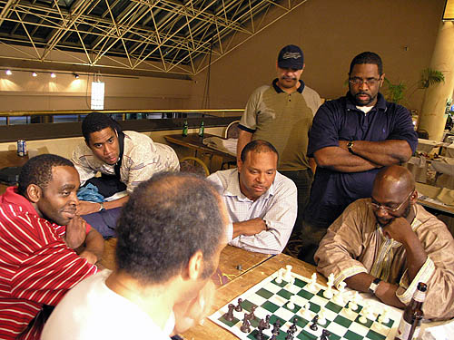 Tate showing his game against Fressinet. Copyright © 2006, Daaim Shabazz.