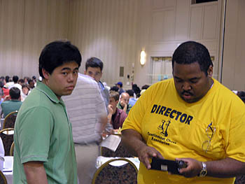 More clock help Nakamura with Boyd Reed.. Copyright © 2006, Daaim Shabazz.