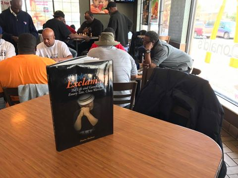Nathan Kelly displaying Triple Exclam in Chicago McDonalds on 95th Halsted