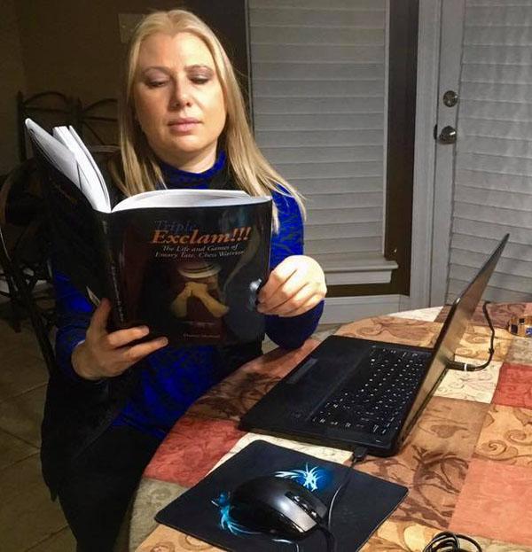 GM Susan Polgar surveys her copy of Triple Exclam!!!